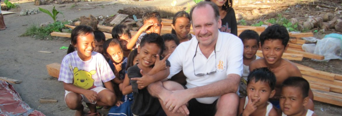 Ron Brown with the children in the Philippines