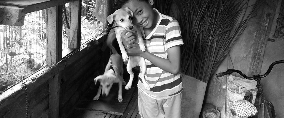 Boy with puppy at Sitio Kasagingan, Tanjay City.