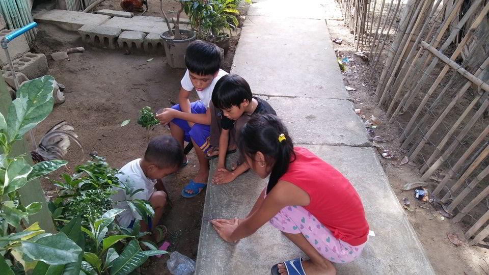 Children playing in the mud at Sitio Kasagingan Tanjay City