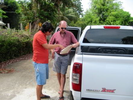 Examining plans for Casa Esperanza of Angels orphanage with Architect Rainier Garcia.