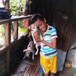 Boy with puppies at Sitio Kasagingan Tanjay City