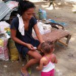 Mother with child at Sitio Kasagingan Tanjay City