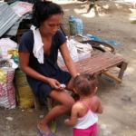 Mother with child at Sitio Kasagingan Tanjay City